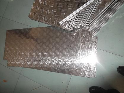 供应3003合金铝花纹板指针轧花铝板0.8mm铝板批发价出售