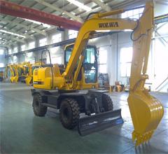 企业龙头沃尔华DLS100-9A 9.7吨轮式挖掘机