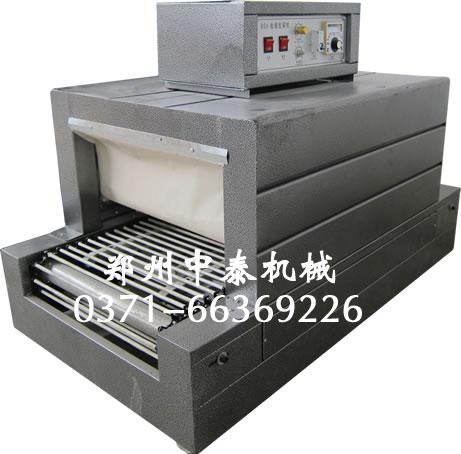 炒锅热收缩包装机、PVC膜热收缩机、羽毛球筒热缩膜机