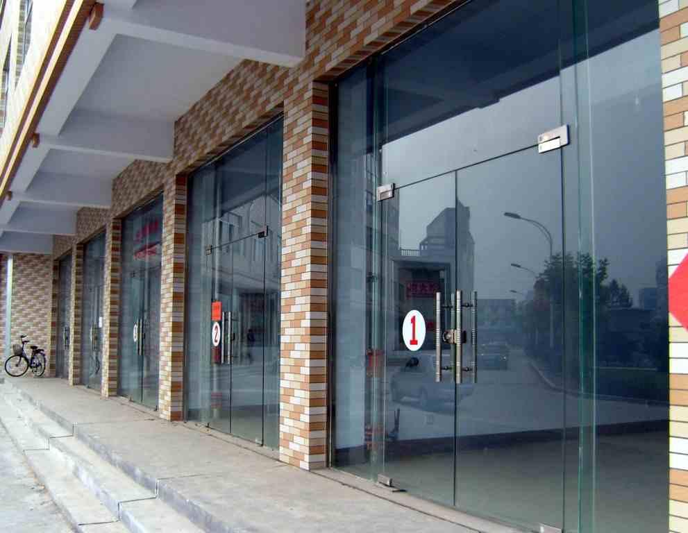 北京维修玻璃门地弹簧安装方法