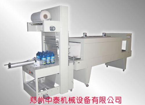 食用油桶自动套膜包装机,蜂窝煤自动套膜包装机,定制各种热收缩包装